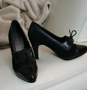 Women's genuine leather high heeled shoes. Size 8. Lace up.