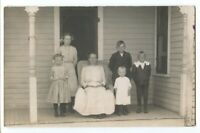 102320 VINTAGE RPPC REAL PHOTO POSTCARD MOTHER AND 5 CHILDREN ON PORCH