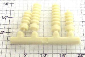 Lionel 2461-3 Set of 4 Off-White Snap-In Transformer Insulators