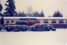 PHOTO  1985 ALRESFORD RAILWAY STATION IN WINTER. STORED WHEELSETS TAKE ON A DIFF