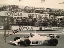 JOHN WATSON - FORMULA 1 RACING DRIVER - SIGNED B/W ACTION PHOTOGRAPH