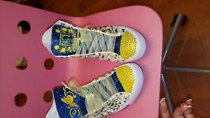 Sigma Gamma Rho hightop Shoes.