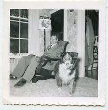 Chair Man's DOG Makes Wolf Eyes Sticks Out Tongue at Camera Vtg 1950s Photo
