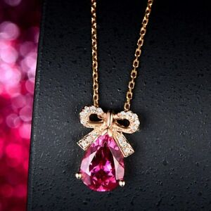 2.60 Carat Pink Ruby And VVS1 Moissanite Drop Bow Pendant In 14k Rose Gold Over