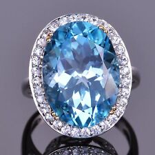 Blue Topaz Oval  and White Sapphire Ring in 14K White Gold