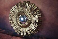 Glace / miroir soleil à pétales en tôle doré avec oeil de sorcière