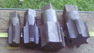 """LOT OF 4 VERY LARGE THREAD CUTTING TAPS 2 AT 2"""" & A1"""" AND A 1 1/4"""" SIZES USED"""