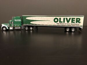 SpecCast #32921 1:64 Scale Oliver Farm Machinery Peterbilt 379 W/ Van Trailer