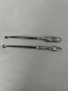 2 antique solid silver handled button hooks hallmarked Birmingham 1898 and 1911