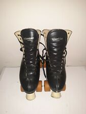 Dominion Canada Mens Roller Skates size 9 with pacesetter wheels.