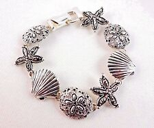 Seashore bracelet starfish scallop sand dollar silver base metal Icon Collection