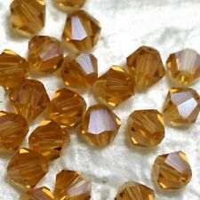 25 Perles Cristal -TOUPIES SWAROVSKI  -  LIGHT TOPAZ       4 mm