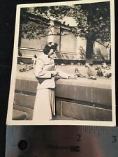 Girl in Dress Feeding Birds Bow in Hair Pigeons Wall