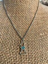 VINTAGE RHODIUM AND TURQUOISE #1 SYMBOL NECKLACE.
