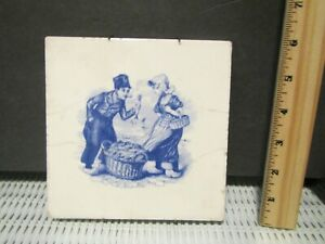 Antique Delft Blue and White Fish Seller and Lady