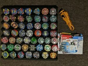 Large Beyblade burst collection (x50 Beys) + Gold launcher + stat cards