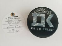 Patrick Kane #88 signed Keith Relief puck 2016 Chicago Blackhawks CoA