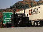 "1/64 DCP ALL BLACK #1 PETERBILT 389 W/ 63"" FLAT TOP SLEEPER"