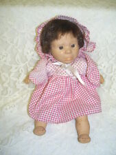 EXPRESSION GI-GO DOLL DRESSED IN RED AND WHITE CHECK DRESS