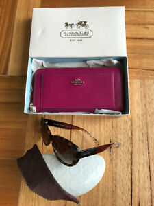 LOT OF 2 COACH ITEMS- ZIP AROUND LARGE WALLET & SUNGLASSES.