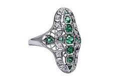 Art Decó Anillo con esmeraldas y diamantes