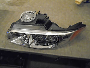 Headlight LEFT MOPAR V7107151AA...NEW...DODGE CARAVAN???  OEM
