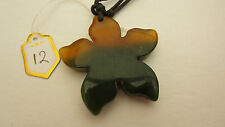 A SUPERB BI-COLOURED FLOWER STYLE AGATE PENDANT ON A WAXED CORD NECKLACE.  (12)