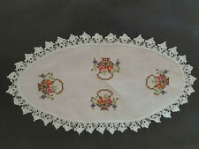 Vintage white embroidered cloth/doily with hand embroidered flowers and baskets.