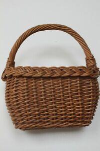 Vintage wicker child`s woven flower basket