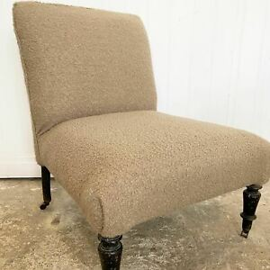 Antique french slipper chair reupholstered in beige boucle fabric