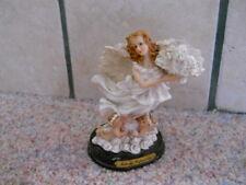 Milano Porcelain Sculpture Angel with Cherubs Figurine by Eda Mann