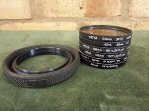 Nice set of 6 58mm Lens filters plus lens hood