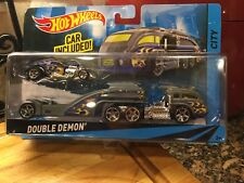 Authentic Hot Wheels Transporter  new with car lot of 2  in sealed package