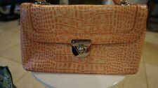 Gorgeous Antonio Melani purse with amazing silver hardwear peach and ivory