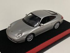 1/43 Minichamps Porsche 911 Carrera ( 996 )   Silver Leather base.   A1019