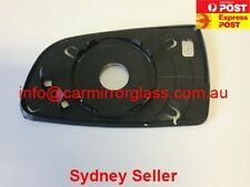 RIGHT DRIVER SIDE HOLDEN BARINA TK HATCH 2008 - 2011 MIRROR GLASS WITH BASE