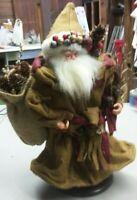 "Santa Figurine 14"" tall robed brown bag of pine cones platform"