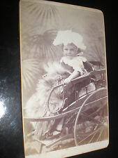Cdv photograph girl in big bonnet with rug in studio carriage c1890s