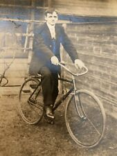 Antique black and white photo Man with Bicycle