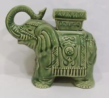 standing green ceramic elephant figurine with saddle