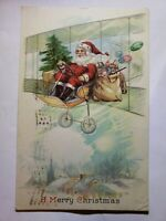 Red Suit Santa Claus Bi-Plane Air Christmas Tree Toys Dropping village Postcard