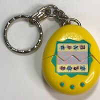 Vintage 1997 McDonalds Kids Meal Tamagotchi Yellow Character Keychain