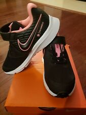 Nike Star Runner size 13c, black with pink swoosh