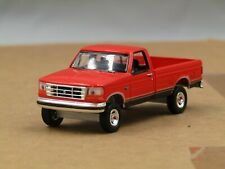 dcp/greenlight CUSTOM lifted 1992 Ford F150 red 1/64..