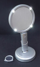 Vanity Mirror.LED lighted.Freestanding/Handheld+magnifying mirror.Batteries inc.