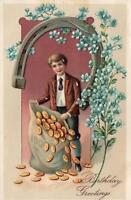 VINTAGE BIRTHDAY GREETINGS BOY & BAG of GOLD COINS HORSESHOE EMBOSSED POSTCARD