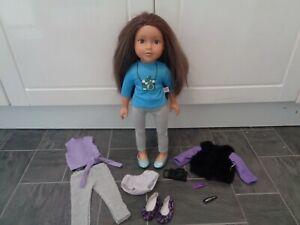design a friend bundle-brunette doll,2 outfits,2 pairs shoes,camera,coat,pants+