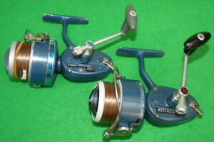 A pair of Garcia & Mitchell 410A spinning reels in light blue finish