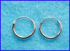 Orecchini di metalli preziosi senza pietre in argento