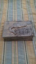 Tin box with fish embossed, hinged lid